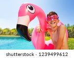 cute boy with swimming ring... | Shutterstock . vector #1239499612