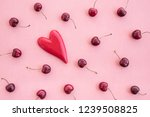 ripe cherries and red wooden... | Shutterstock . vector #1239508825