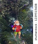 a jolly santa claus ornament... | Shutterstock . vector #1239515608
