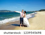 bride and groom at the beach ...   Shutterstock . vector #1239545698