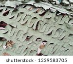 camouflage green mesh. abstract ...   Shutterstock . vector #1239583705