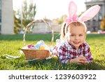 cute little girl with bunny... | Shutterstock . vector #1239603922