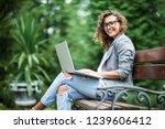 side view of pleased brunette...   Shutterstock . vector #1239606412
