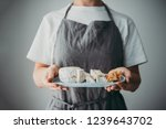 hands holding a plate with... | Shutterstock . vector #1239643702