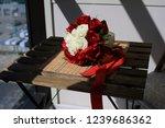 the bride's bouquet awaits.... | Shutterstock . vector #1239686362