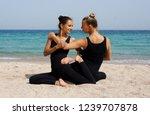girls practice acro yoga in... | Shutterstock . vector #1239707878