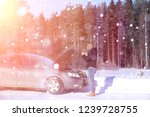 a man stands in front of a...   Shutterstock . vector #1239728755