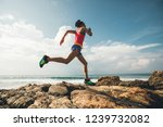 young fitness woman trail...   Shutterstock . vector #1239732082