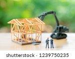 miniature businessmen standing...   Shutterstock . vector #1239750235
