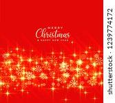 shiny golden christmas sparkles ... | Shutterstock .eps vector #1239774172