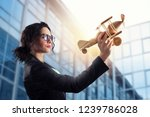 businesswoman play with a toy... | Shutterstock . vector #1239786028