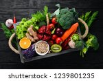 fresh vegetables and fruits in... | Shutterstock . vector #1239801235