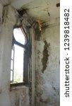 windows of abandoned castle in... | Shutterstock . vector #1239818482