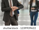 businessman checking time on... | Shutterstock . vector #1239939622