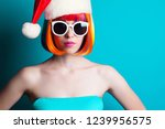 beautiful model with red santa... | Shutterstock . vector #1239956575