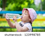 two year child drinks from... | Shutterstock . vector #123998785