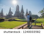 traveling man are taking photos ... | Shutterstock . vector #1240033582