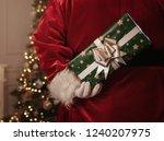 santa claus holding christmas... | Shutterstock . vector #1240207975