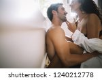 young couple being intimate in... | Shutterstock . vector #1240212778