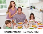 family smiling at the dinner... | Shutterstock . vector #124022782