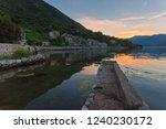 gloomy sea sunset on mountains...   Shutterstock . vector #1240230172