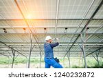 young electrician in hard hat... | Shutterstock . vector #1240232872