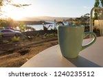 lakeside coffee mug   table at...   Shutterstock . vector #1240235512