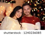 happy young couple sitting at... | Shutterstock . vector #1240236085