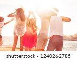 joyful friends dancing on the... | Shutterstock . vector #1240262785