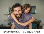 smiling dad giving his young... | Shutterstock . vector #1240277785