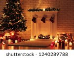 white decorated fireplace near... | Shutterstock . vector #1240289788