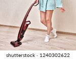 cleaning lady in a blue robe... | Shutterstock . vector #1240302622