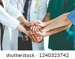 group of happy doctor surgeon... | Shutterstock . vector #1240323742
