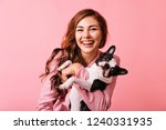 Stock photo wonderful european female model chilling in studio with puppy indoor portrait of debonair girl 1240331935
