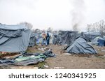 refugee and migrant camp in... | Shutterstock . vector #1240341925
