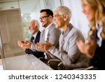 satisfied proud business team... | Shutterstock . vector #1240343335
