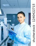 young female scientist working... | Shutterstock . vector #1240422715