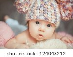 Stock photo adorable smiling newborn baby girl lies in basket 124043212