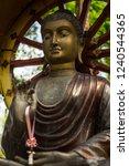 buddha statue on a dharma wheel ... | Shutterstock . vector #1240544365