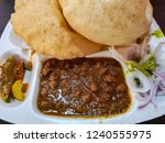 chole bhature for breakfast... | Shutterstock . vector #1240555975