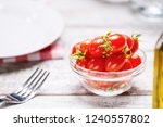 fresh organic cherry tomatoes.... | Shutterstock . vector #1240557802