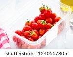fresh organic cherry tomatoes ... | Shutterstock . vector #1240557805