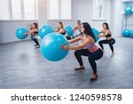 young fitness women with blue... | Shutterstock . vector #1240598578