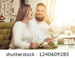 happy man and woman have lunch...   Shutterstock . vector #1240609285