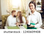 beautiful girl waiter holds...   Shutterstock . vector #1240609408