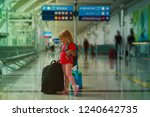 little girl with suitcases... | Shutterstock . vector #1240642735