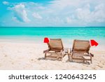 christmas on beach  chair... | Shutterstock . vector #1240643245