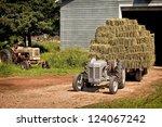 Vintage Tractor Hauling A Wago...