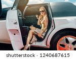 vip woman and man getting out... | Shutterstock . vector #1240687615