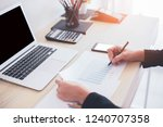 asian women writing on charts... | Shutterstock . vector #1240707358